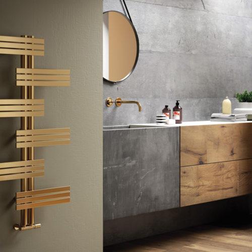 Фото Радиатор дизайнерский в современном стиле золотого цвета. Коллекция BABYLA , Италия